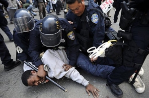 May_Day_General_Strike_young_Black_man_on_ground_tasered_dntn_Oakland_050112_by_Michael_Short_Special_to_Chron